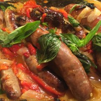 Baked Italian Sausages with red capsicum and onions