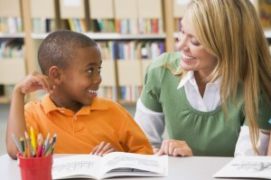 © Monkeybusinessimages | Dreamstime.com Teacher helping student with reading skills.