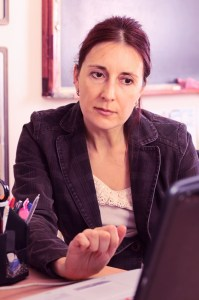 teacher at laptop © Igorr | Dreamstime.com