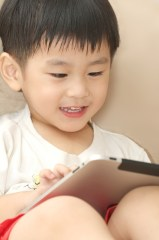 c-billysiew-_dreamstime_com-boy-using-ipad.jpg