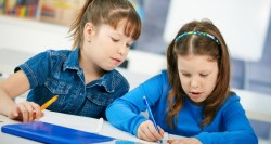 twin-girls-learning-in-classroom-c-nyul-dreamstime_com
