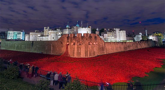 888,246 ceramic poppies, each poppy representing a British fatality during World War . (photo by Mez Merrill