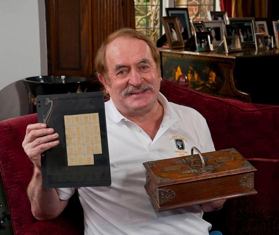Stamp dealer Allan Grant with stamps and cigar box Photo © Chris Balcombe