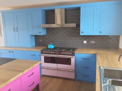 Shaker Style - Pale blue cooker surround with pink kitchen island