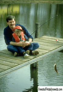 man and child fishing on a dock