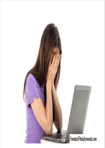 woman head down over laptop