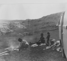 """Here's a picture of my mom cooking barbecue at Seal Point, South Africa, with Eddie, me, my sister and our combi, 1972."""