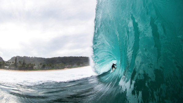 With the surf community's attention focused on the North Shore throughout the winter season, Koa Rothman showcases his talent and mettle by pulling into this Pipeline pit. Photo: Keoki