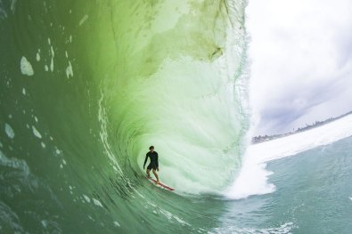 Wave colors are synonomous to their break, like the Nias green and deep brown decorated by Nathan Florence standing tall. Photo: Keoki