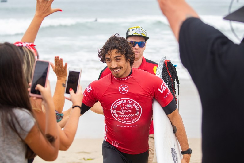 HUNTINGTON BEACH, UNITED STATES - August 4: Yago Dora of Brazil advances to the Semifinals of the 2019 VANS US Open of Surfing after winning Quarterfinal Heat 2 at Huntington Beach on August 4, 2019 in CA, USA. (Photo by Kenny Morris/WSL via Getty Images)