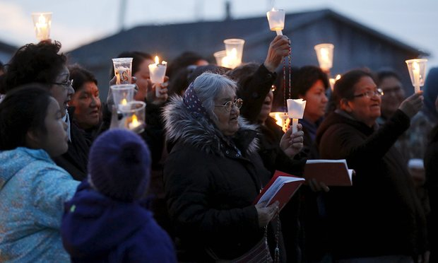 People take part in a candlelight vigil Attawapiskat. Photograph: Chris Wattie/Reuters