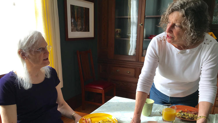 Kate and Linda Rohr sit down for breakfast on Valentine's Day at their home in Fort Bragg, Calif. Later that week, Kate would have her gender-affirmation surgery. (Amy Ellis Nutt / Washington Post)