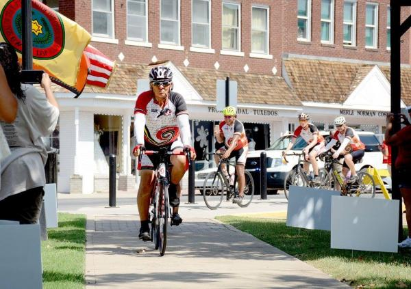 Courtesy Cherokee Nation Remember the Removal Bike Ride Elder Ambassador and Cherokee Nation citizen Sammy Houseberg leads the cyclists to the Cherokee Nation Courthouse as they complete the 950-mile trek.