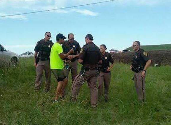 On day three, after realizing the water protectors are peacefully trying to protect their water from a Texas-based oil company, many officers chose to show respect for morning prayer songs and those who offered to smudge them. (Photo: Courtesy No Dakota Access Pipeline).