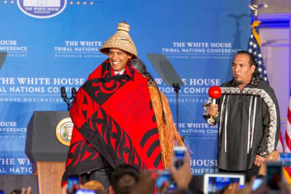 As President Barack Obama took the stage at the 8th Annual White House Tribal Nations Conference (WHTNC) National Congress of American Indians President Brian Cladoosby broke the age-old rule from Politico that presidents should never wear a hat. Alex Hamer.