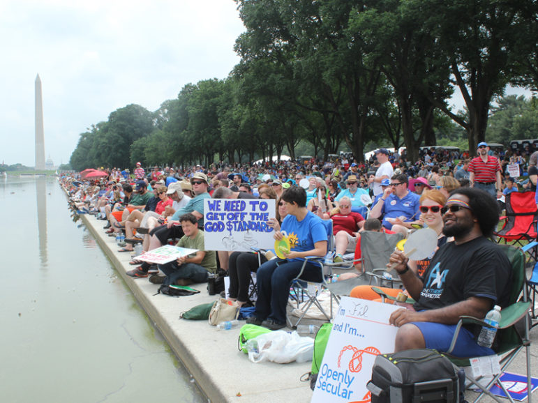 Crowds of atheists and other freethinkers assembled by the Lincoln Memorial reflecting pool for the Reason Rally on June 4, 2016, in Washington, D.C. RNS photo by Adelle M. Banks.