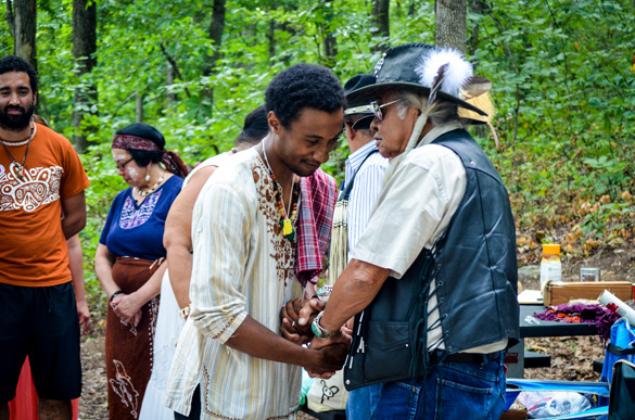 Peace and Dignity runner from Kingston Jamaica, Kalaan Robert Nibonrix (Taino), formally greeting elder Chumsey Harjo (Muscogee Creek Nation) during the closing ceremony of the Eastern Red Tail Hawk route July 23, 2016. (Amy Morris)
