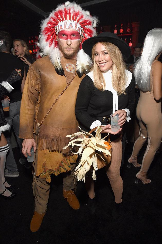Hillary Duff and Boyfriend Jason Walsh Dress as Pilgrim and Native American 'Chief' - MICHAEL KOVAC/GETTY IMAGES.