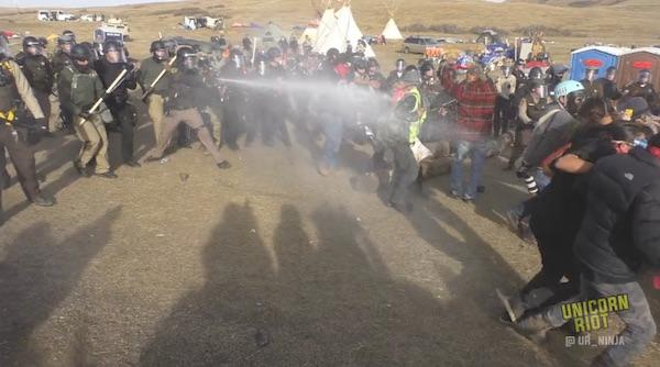 Unicorn Riot/Vimeo Officers liberally douse water protectors with pepper spray at the front lines of the resistance to the Dakota Access Pipeline.