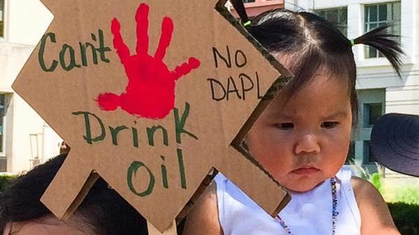 A youthful supporter of the campaign to stop the Dakota Access Pipeline. cool revolution via Flickr.