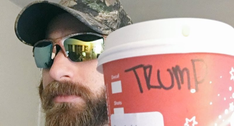 A Trump fan proudly shows off his Trump Starbucks cup (Twitter).