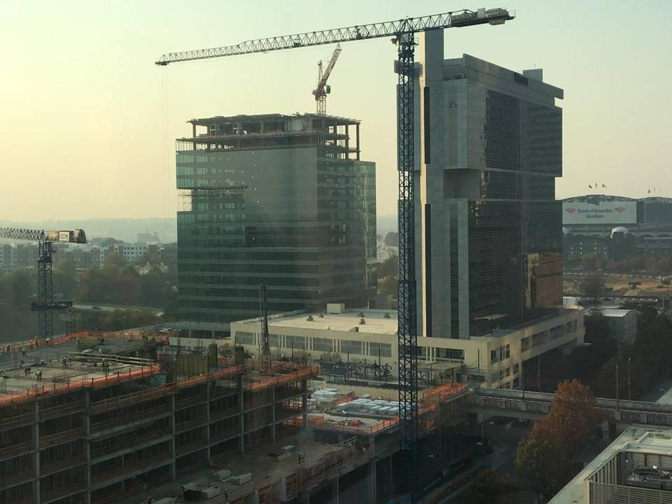 Before choosing Richmond, Va., real estate research firm CoStar Group was looking to take space at the 615 South College office tower (center) currently under construction in uptown. Rick Rothacker rrothacker@charlotteobserver.com.