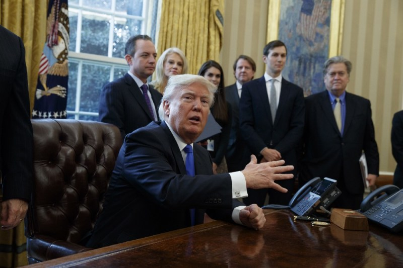 President Donald Trump talks with reporters n the Oval Office of the White House on Tuesday. CREDIT: AP Photo/Evan Vucci.