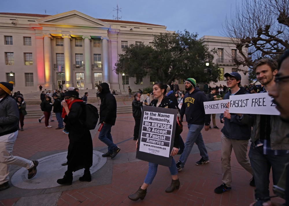 Students protest Milo Yiannopoulos' appearance at UC Berkeley Wednesday evening. CREDIT: AP Photo/Ben Margot.