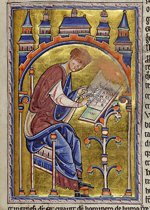 Isidore sits on a chair, writing on a sloping desk the words '(ysid)oris (de) natu(ra) hominisI' Isidore, Concerning the Nature of Man.