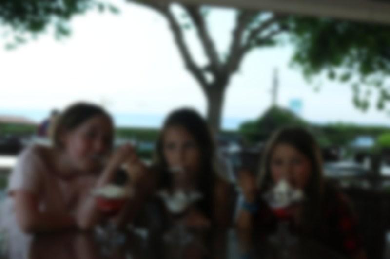 pixellated image of three girls eating ice cream.