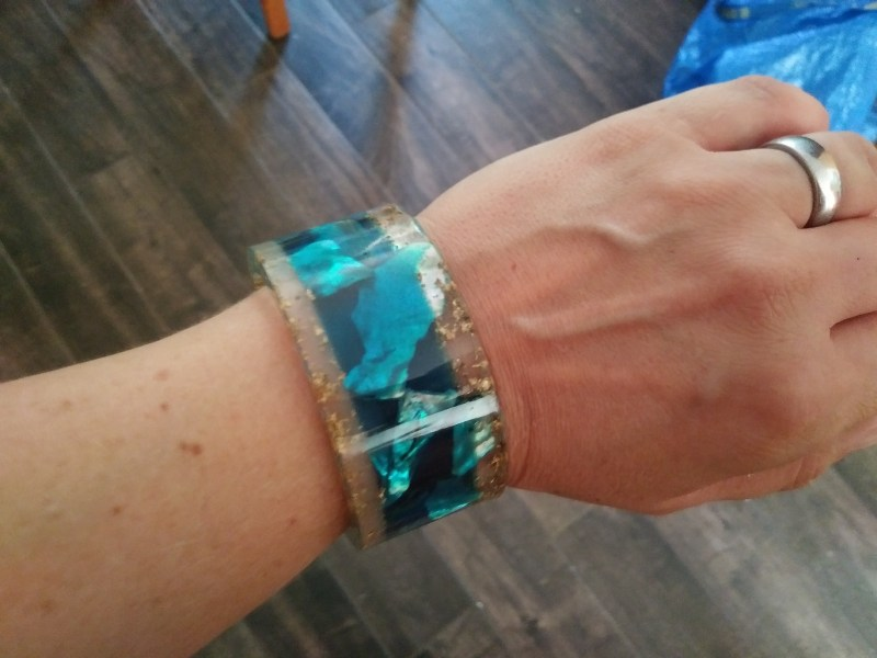 clear, blue and gold bracelet with seashells