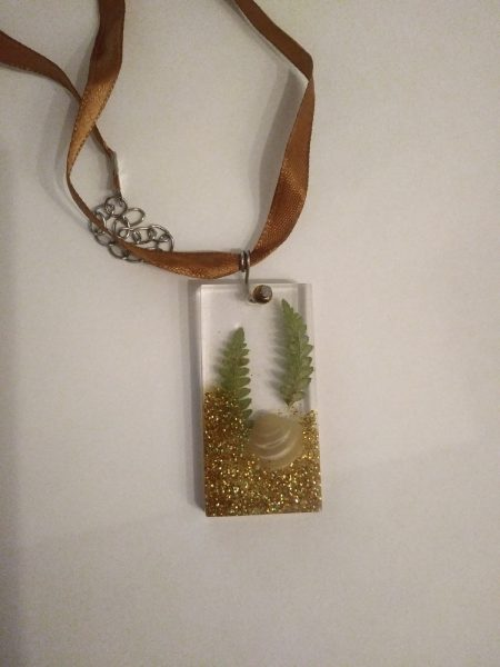 resin necklace with seashell and plants