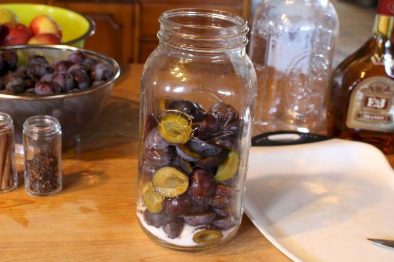 plums in a mason jar