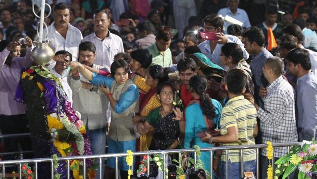 hmednagar: Bhumata Brigade chief Trupti Desai offering prayer at the Shani Shingnapur temple after the gates were opened for women, in Ahmednagar on Friday, April 8, 2016. (PTI)