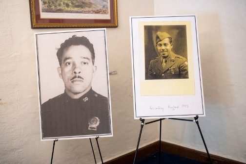 Photos of Osceala Fletcher from his service in the Army during World War II and his time as a sargent in the NYPD (l) were displayed inside the Fort Hamilton Army Base. (GREGG VIGLIOTTI/for New York Daily News)