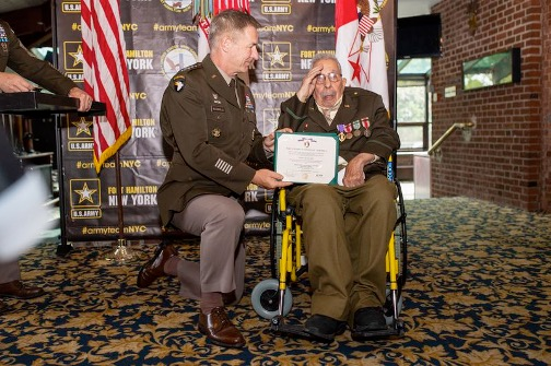 Osceala Fletcher (r) receives a Purple Heart at the Fort Hamilton Army Base, almost 77 years after he was wounded. (GREGG VIGLIOTTI/for New York Daily News)