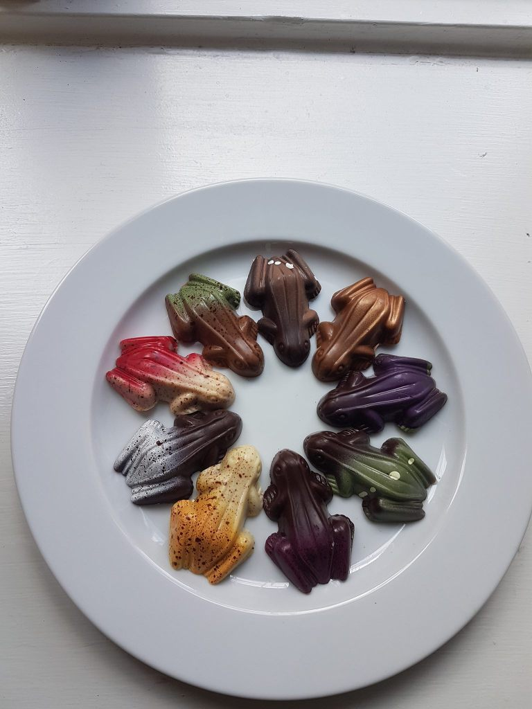Chocolate frogs on plate