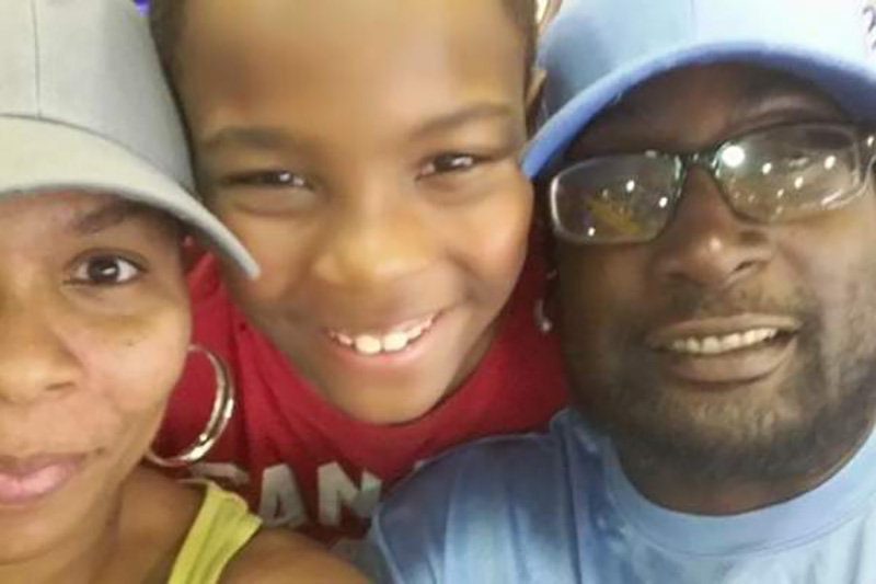 Keith Lamont Scott, right, with his wife and son