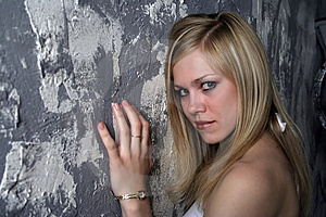 Stock Photo - The beautiful blonde at a wall