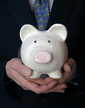 Free Stock Image - Businessman holding a piggy bank