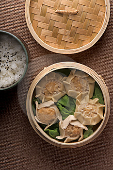 Stock Image - Dumplings and rice in baskets