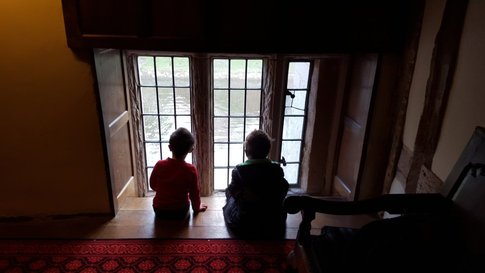 Children overlooking the moat at Baddesley Clinton