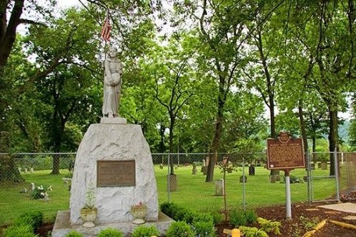This memorial features Betty Zane with her apron heavily laden with black powder.