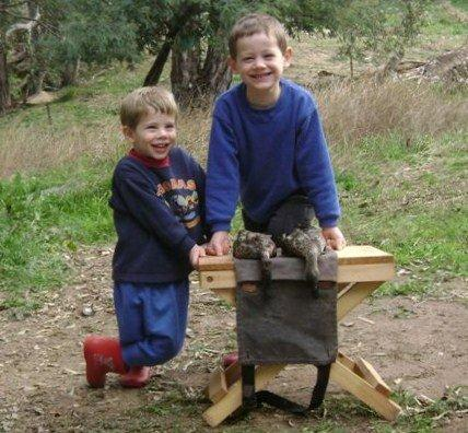 Two happy young lads learn about the food chain.