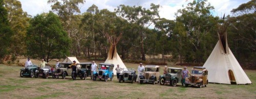 Austin 7 drivers line up with their beautifully restored cars on the Painted Pony Plains, Caveat.