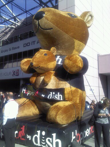 Giant plush Hopper advertising Dish Network in front of CES
