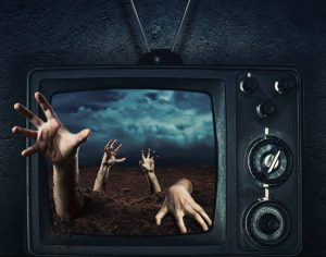 Zombie hand coming out of his grave from TV