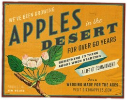 A bold vintage orange sign for an apple orchard in the desert!