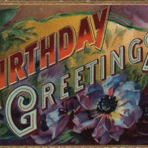 Vintage birthday card with colorful flowers in public domain.
