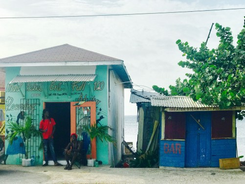 Mad Rebel Recording Studio with two musicians out front of the ocean-front recording studio| Negril, Jamaica | Photo Credit: Michael Morahan